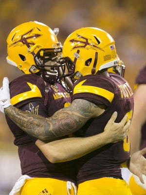 QB Mike Bercovici, left, and WR D.J. Foster were named ASU's co-offensive most valuable players Saturday night.