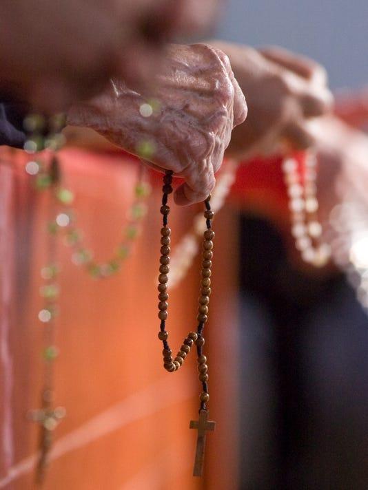 635721737753061185-rosary