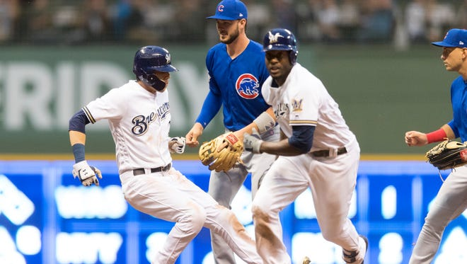 All eyes of the Cubs players are focused on the Christian Yelich rundown as Lorenzo Cain heads back to first where no one is covering the base during the third inning Tuesday night.