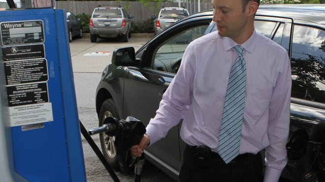 Adam Denker fills up at a Mobil station in Mount Kisco.