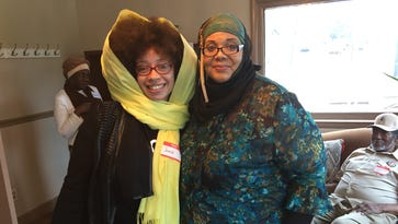 Jamila Tyrrell, left, and Karen Shakir welcome visitors to the Muslim American Cultural Center on Jefferson Street in North Nashville. The center held an open house on March 25, 2017
