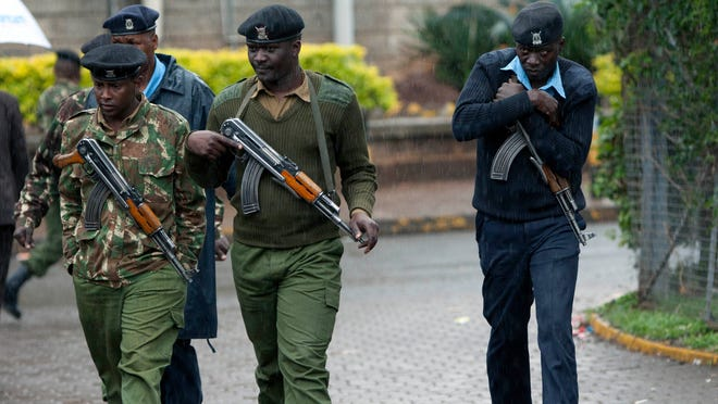 Kenyan army soldiers and police officers patrol near the Westgate Mall in Nairobi on Sept. 24.