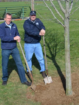 Mayor Tom Kramer and DMS Director Dave Sattler at one of their annual Arbor Day tree plantings.
