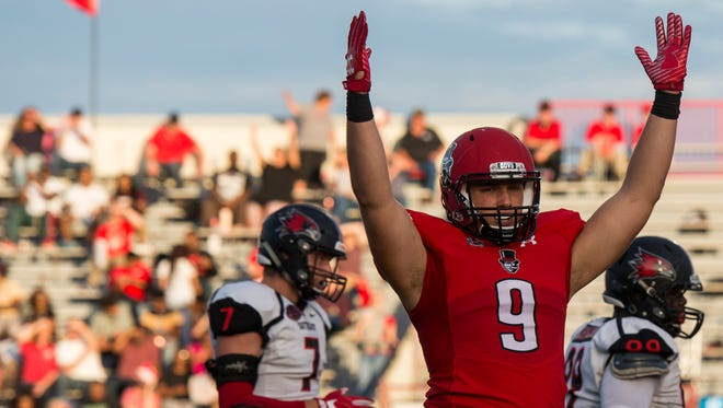 Elijah Brown, 9, raises his arms after his teammate Kentel Williams scored a touchdown for Austin Peay on October 21, 2017.