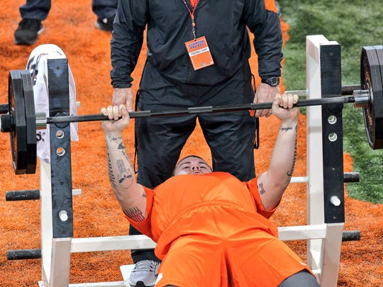Jay Guillermo lifts 225 pounds 33 times before NFL scouts on Thursday during Clemson pro day at the indoor football facility in Clemson. Players evaluated are considered by 32 professional teams during the 2017 NFL Draft from April 27-29.