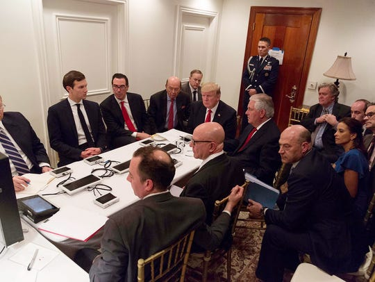 In this photo released by the White House Press Secretary