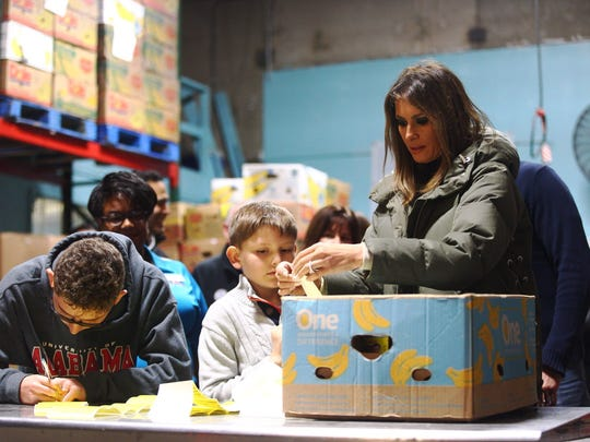 First lady Melania Trump helps label boxes Wednesday, Dec. 6, 2017, during a visit to the Coastal Bend Food Bank. Trump and second lady Karen Pence spent the day touring the Coastal Bend.