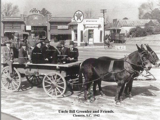 Uncle Bill Greenlee, in his wagon with a group of dignitaries