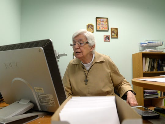 Sister Mary Alice writes thank-you notes for donors