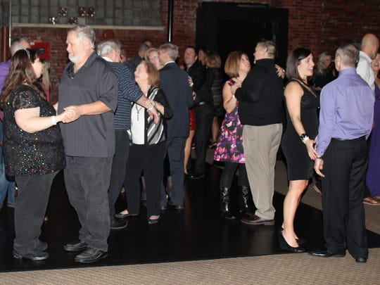 A crowd of about 200 people enjoyed dinner and dancing during the Downtown Marion, Inc. New Year's Eve party last year.