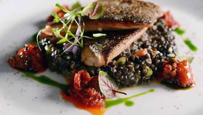 Sunburst trout on a bed of beluga lentils is on the menu at the Market Place.