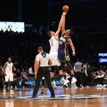 Feb 3, 2016; Brooklyn, NY, USA;  Brooklyn Nets center Brook Lopez (11) and Indiana Pacers forward Myles Turner (33) tip off at Barclays Center. Mandatory Credit: Anthony Gruppuso-USA TODAY Sports