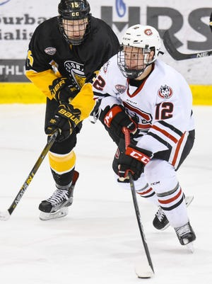 St. Cloud State's Jack Ahcan (12) skates the puck past Colorado College's Mason Bergh at the Herb Books National Hockey Center. Ahcan, a freshman defenseman, was named to the NCHC's All-Rookie Team.