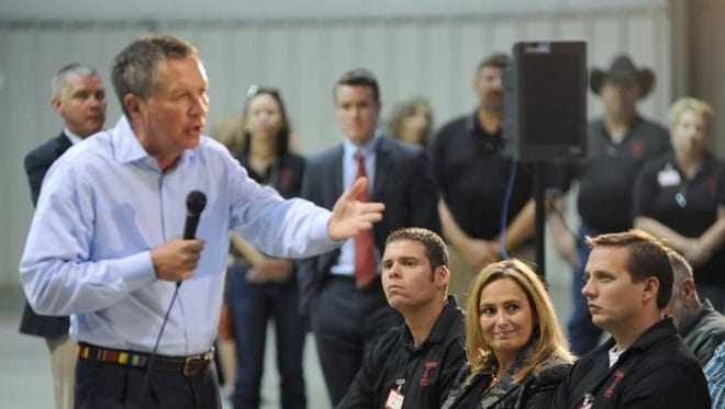 Gov. John Kasich addresses a crowd gathered in Waverly for the announcement of a Rural King distribution center. The governor has touted the state's economic turnaround as one of his key accomplishments.