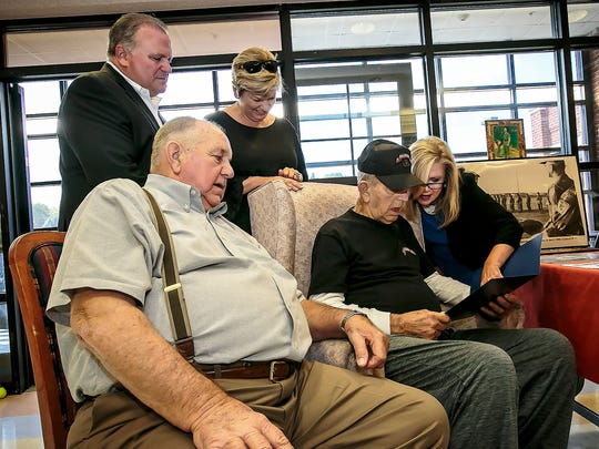 U.S. Congresswoman Marsha Blackburn, right, reads a citation presented to John Dorval Minatra, seated with hat, during a ceremony honoring his military service as a ranger in the U.S. Army. Watching is his brother Lane Minatra and son in law Mike Firetti and daughter Melissa Firetti. Jim Davis/for the DNJ