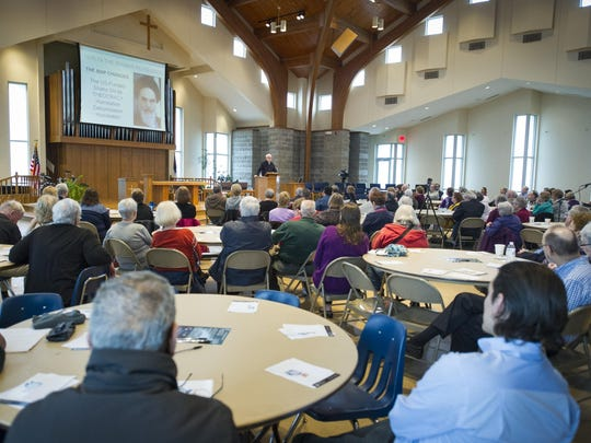 More than 100 people attended an event Saturday at Faith Presbyterian Church in Indianapolis, where David Carlson, a professor of religious studies at Franklin College, spoke about Islam and the political differences between the U.S. and Middle Eastern nations. The event was co-sponsored by the Ahmadiyya Muslim Community of Indiana.