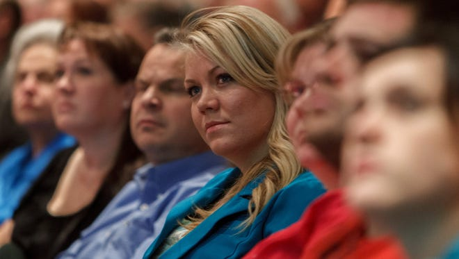 In this Nov. 30, 2012, photo, Elissa Wall attends a community meeting regarding the United Effort Plan (UEP) trust,  in Colorado City, Ariz. Her testimony against polygamous church leader Warren Jeffs helped convict him in 2007 of being an accomplice to her rape in Utah.