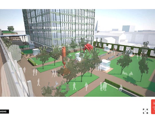 An upper-floor view of parks and green space feature prominently in this architect's rendering of a proposed redevelopment of Burlington Town Center.