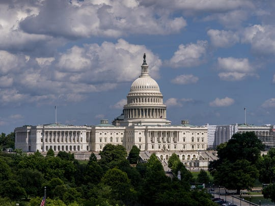 "FILE - In this June 20, 2019, file photo, the Capitol is seen from the roof of the Canadian Embassy in Washington. America's much-maligned health care system is covering more people than ever, a fact lost on many of the 2020 presidential candidates, who keep debating polarizing ideas about how to set up coverage, from Sen. Bernie Sanders' call for replacing private insurance with a government plan, to President Donald Trump's determination to erase ""Obamacare."" (AP Photo/J. Scott Applewhite, File)"