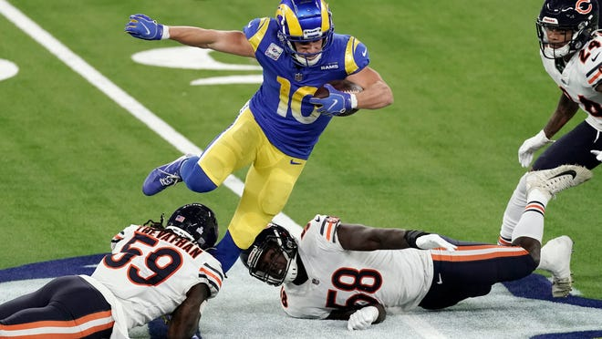 Rams wide receiver Cooper Kupp, top, leaps over Bears inside linebacker Danny Trevathan (59) and inside linebacker Roquan Smith (58) during the second half Monday night in Inglewood, California.