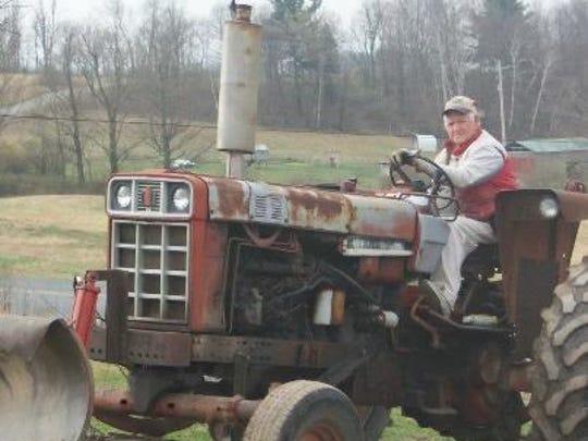 Arden Tewksbury on his tractor.