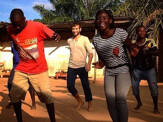 Sal Lavallo doing an East African line dance with a Tanzanian dance troupe.
