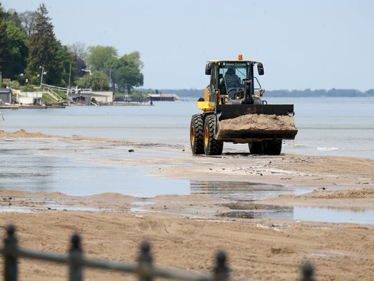 Monroe County crews are trying to rebuild Ontario Beach Park after high lake waters flooded area beaches.