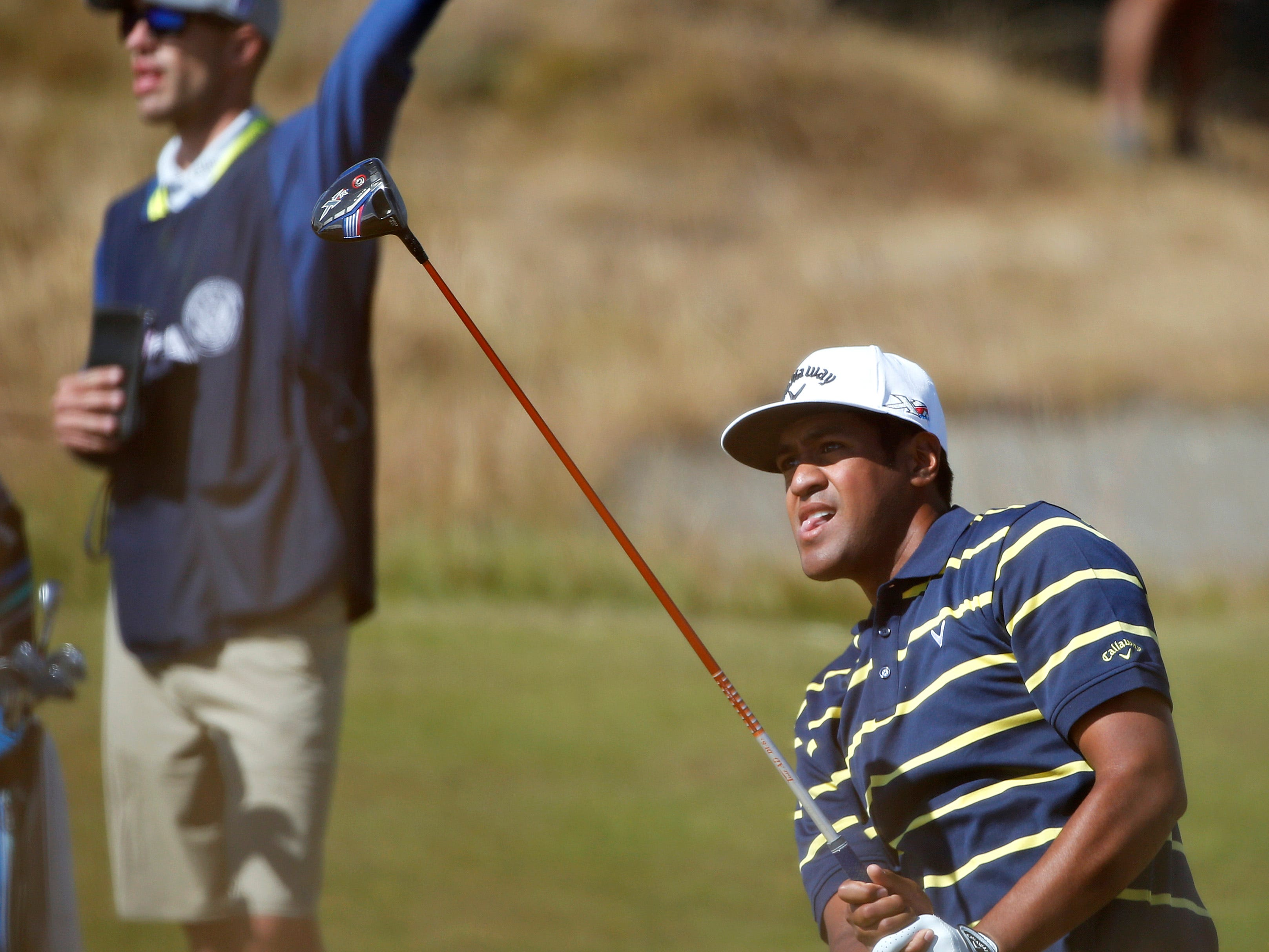 Tony Finau watches his tee shot on the 18th hole during the second round of the U.S. Open golf tournament at Chambers Bay on Friday, June 19, 2015 in University Place, Wash. (AP Photo/Lenny Ignelzi)