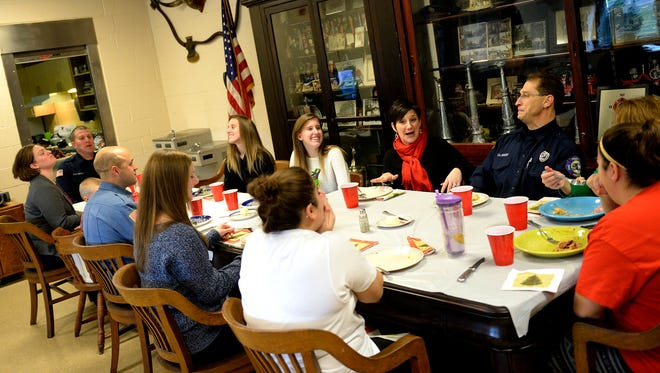 """Despite having to work on Christmas Day, the Lebanon City firefigthers from """"C"""" Platoon managed to have a little family time at fire station one at 8th and Orange streets in Lebanon on Thursday, Dec. 25, 2014. The firefighters famiies' brought dinner and desert to the firehouse so everyone could enjoy some quality family time and a great holiday meal."""