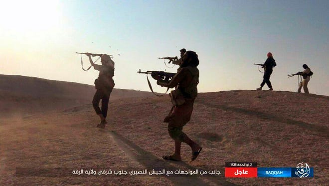 This undated image posted online on Aug 24, 2017, by supporters of the Islamic State on an anonymous photo sharing website, purports to show ISIS fighters firing their weapons during clashes with Syrian troops in Raqqa, Syria.