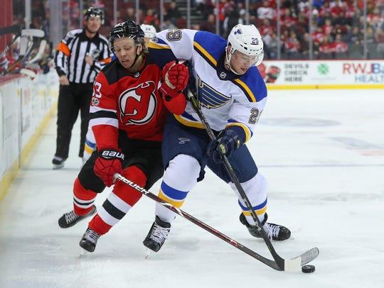 St. Louis Blues defenseman Vince Dunn (29) and New