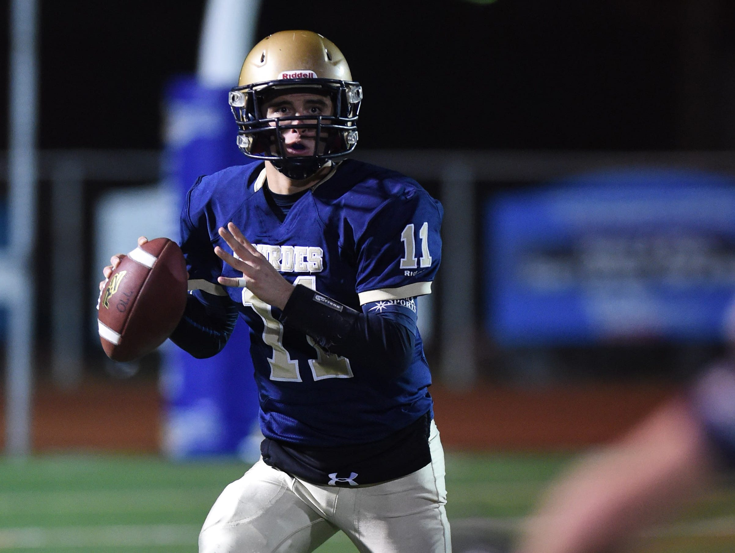 Our Lady of Lourdes High School's Dean Rotger looks to pass the ball during the state Class A semifinals against Amsterdam at Dietz Stadium.