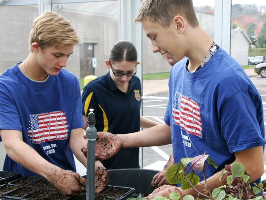 In this file photo, students get their hands dirty in the Wausau West greenhouse.