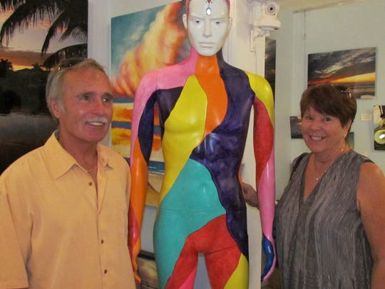 Bill and Arlene Harris pose with Ken the mannequin.