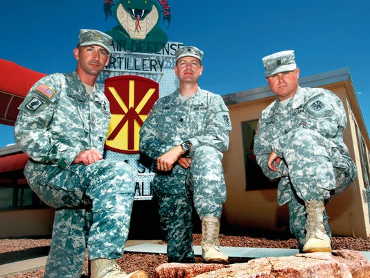 Maj. John Kirchgessner, left, Lt. Col. Glenn Henke, center, and Command Sgt. Maj. John Young with the 1st Battalion, 43rd Air Defense Artillery Regiment, 11th Air Defense Artillery Brigade.