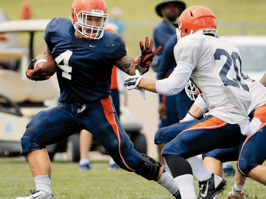 UTEP running back Jeremiah Laufasa tries to avoid defensive back Nik Needham during UTEP's first day in full pads at Camp Ruidoso Monday.