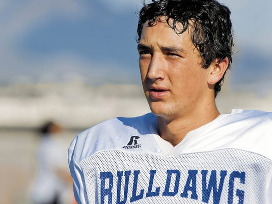 Gary Mook/For the Las Cruces Sun-News   Las Cruces senior Sam Ellis came off the bench to play quarterback last season and help the Bulldawgs reach the state playoffs. Ellis also plays wide receiver and defensive back.