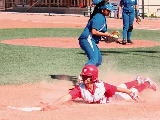 Danny Udero/Sun-News   Cobre's softball team was aggresssive on the bases Tuesday against Socorro. The Lady Indians took care of the Lady Warriors in a doubleheader.