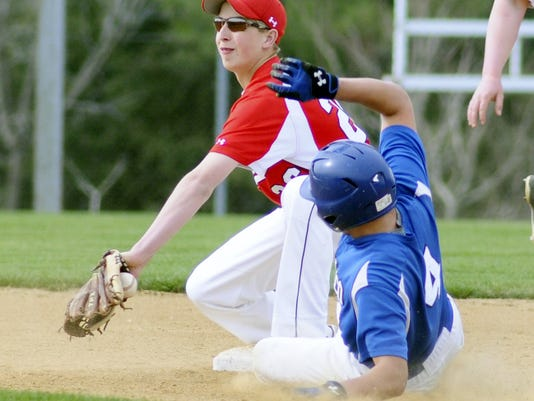 Annville-Cleona's Tyler Shrader looks to tag Cocalico's Justin Burd during a regular-season, L-L crossover game at Annville-Cleona High School on Wednesday.