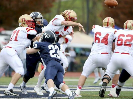 Lebanon Valley College #23 Reid Pavlik tackles King's College #17 Dallas Arner (quarterback) at Arnold Field on November 07, 2015.
