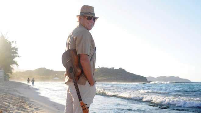 This undated image shows singer Jimmy Buffett on the Caribbean island of St. Barts. Buffett will serve as U.S. ambassador for the Les Voiles de Saint-Barth, an April sailing regatta and mainstay on the Caribbean yacht racing circuit. The island was hard hit by Hurricane Irma and Buffett says he hopes his support for the regatta will help as locals work toward getting back to normal.