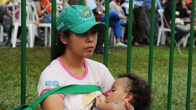 A Brazilian activist breastfeeds her child during the last day of the People's Summit at Flamengo Park in Rio de Janeiro, Brazil, in 2012.
