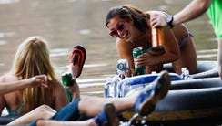 Tubers float on the Salt River during opening day for