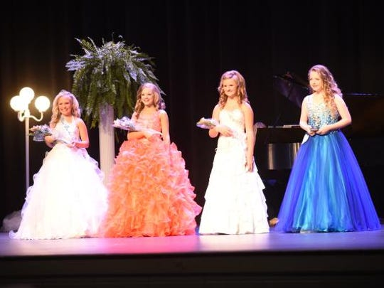 Miss Baxter County Audrieanna Corcoran, left, stands with other winners Alianna Boucher (1st Alternate), Hailey Cordell (2nd Alternate) and Afton Massey (People's Choice) on Saturday night in Dunbar Auditorium.