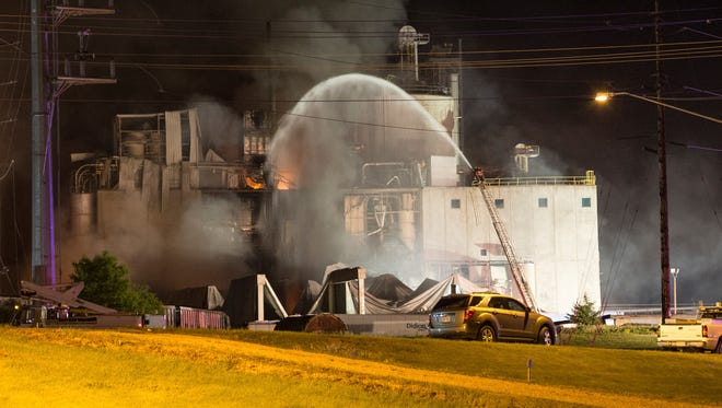 This Thursday, June 1, 2017, photo provided by Jeff Lange shows the scene following a fatal explosion and fire at the Didion Milling plant in Cambria, Wis. Recovery crews searched a mountain of debris on Thursday following a fatal explosion late Wednesday at the corn mill plant, which injured about a dozen people and leveled parts of the sprawling facility in southern Wisconsin, authorities said.