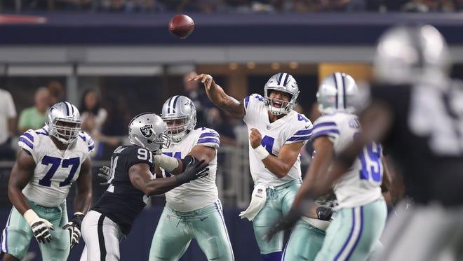 Dallas Cowboys quarterback Dak Prescott (4) throws in the pocket against the Oakland Raiders at AT&T Stadium.
