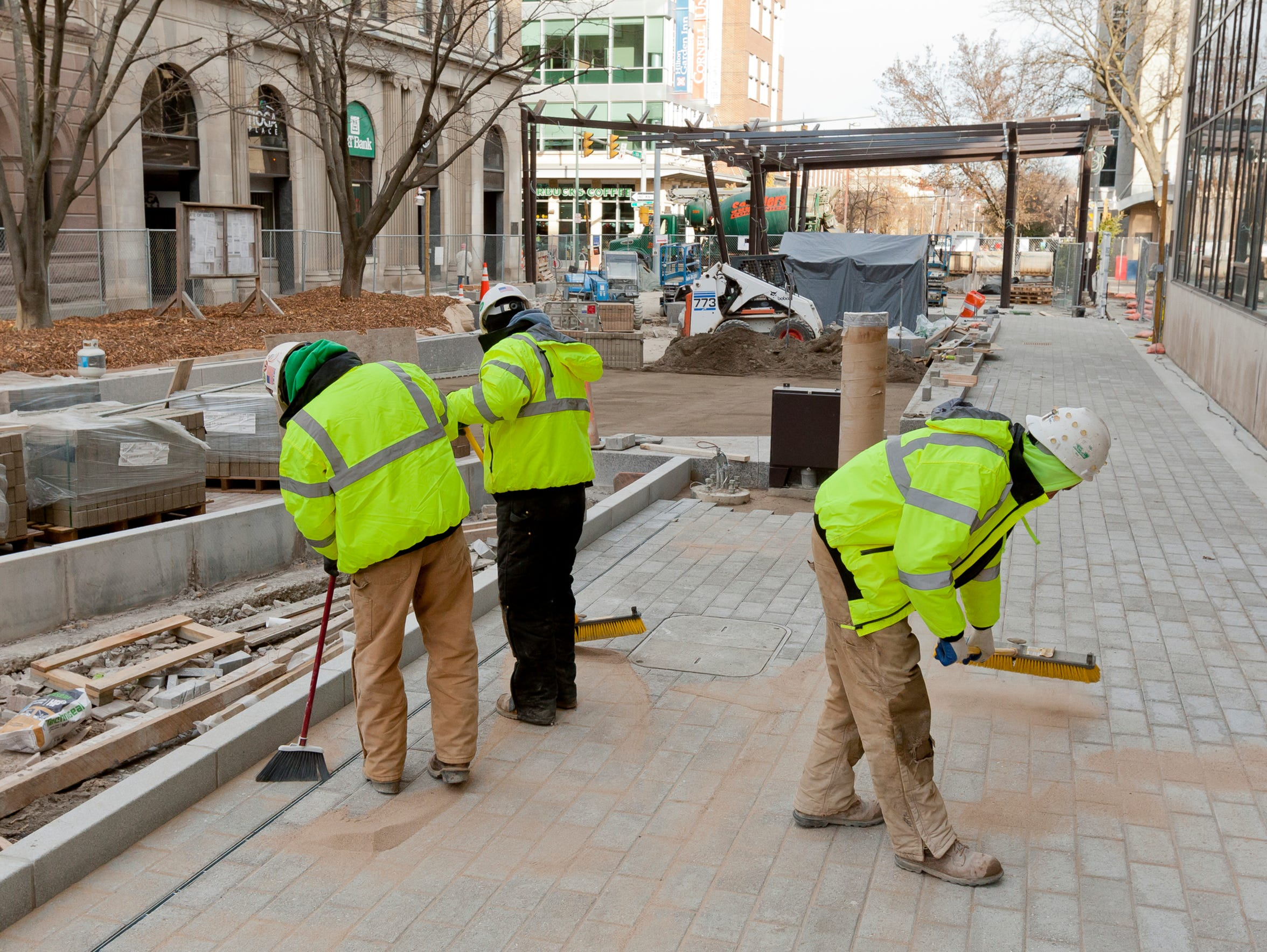 Contractors put the finishing touches on the new brick