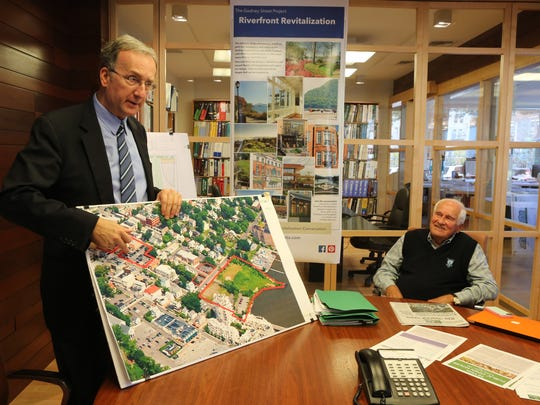 Architect Drazen Cackovic, shown at left in 2015 discussing the proposed TZ Vista development in Nyack, said on Tuesday that TZ Vista, which is partly owned by developer Bill Helmer, right, is sending $100 gift cards to those towed from the private parking lot on Main Street.