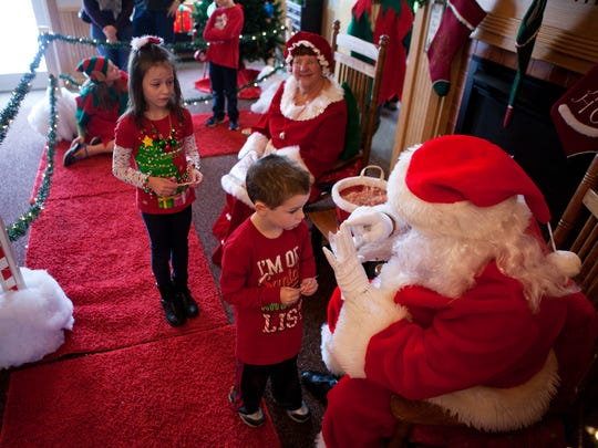 Grayann and Forest Milligan meet with Mr. and Mrs. Claus at Springdale Farm in 2014.