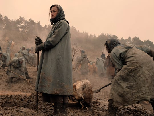 "Alexis Bledel stars as Ofglen in ""The Handmaid's Tale,"""